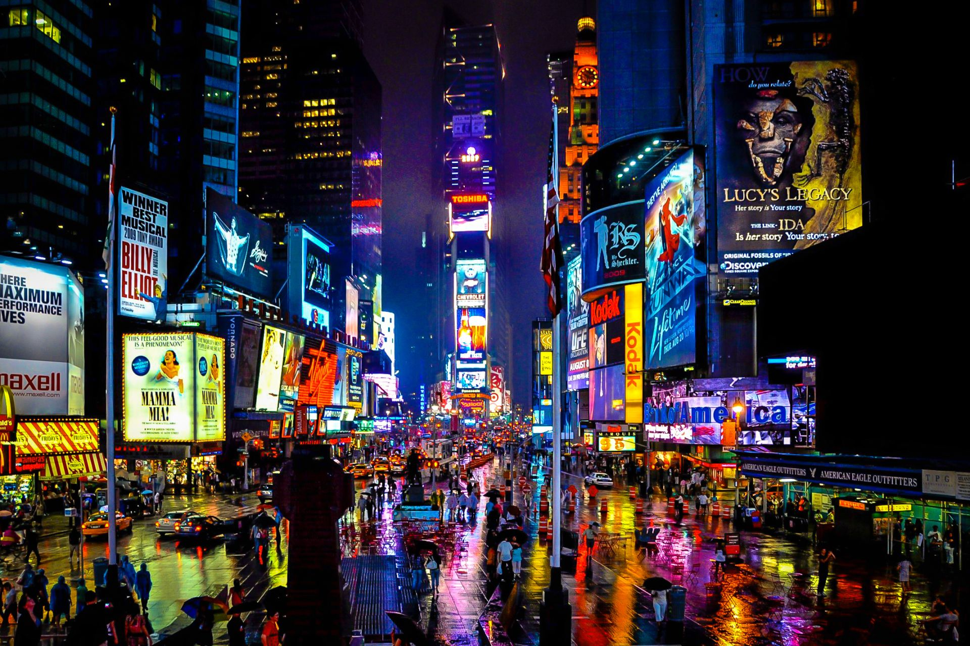 Times Square on a rainy, magical night